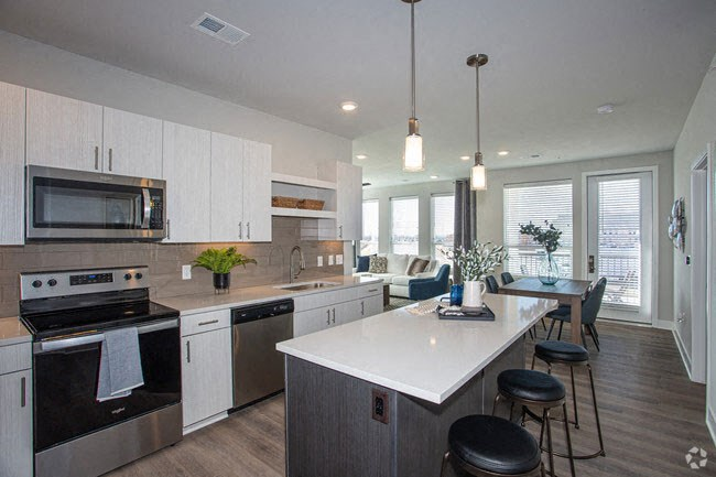 Gourmet Kitchen With Island at Revolve at OneFifteen, Kansas