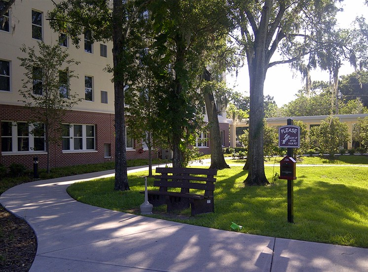 neat sidewalk and bench for resting in courtyard