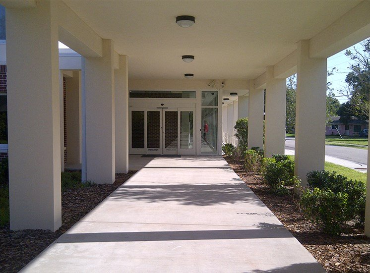 covered walkway with neat landscaping at St. Giles Manor II