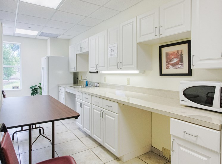Community kitchen with microwave at St. Giles Manor