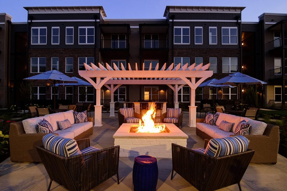 Duncan Park, Columbus, OH luxury apartment complex exterior with Fire pit, grill, and pergola, Columbus, OH