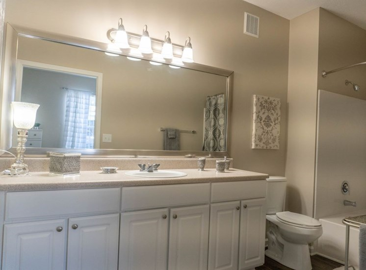 Relax after a long day in your bathroom with garden soaking tub, unique cabinets, LED lighting at The Shallowford Apartment Homes, Chattanooga, TN 37421