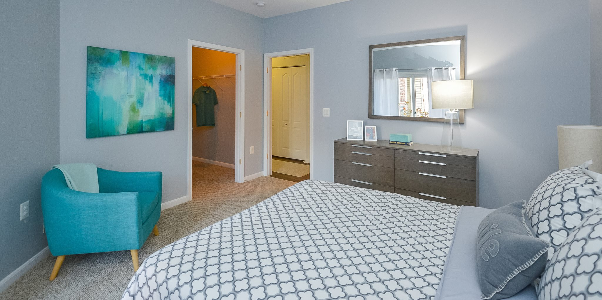 model apartment, bedroom with view of bath and closet entry
