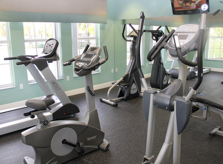 fitness center with bikes andtreadmills