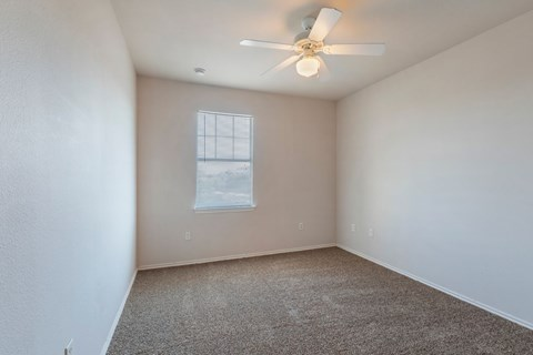 Bedroom with Ceiling Fan and Wall to Wall Carpet