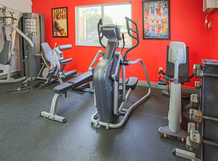 fully-equipped fitness center with free weights