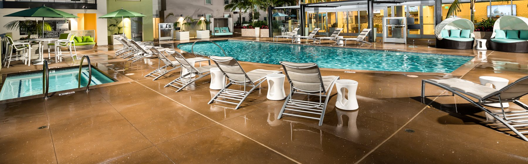Vive on the Park Apartments Pool Area and Lounge Chairs Banner