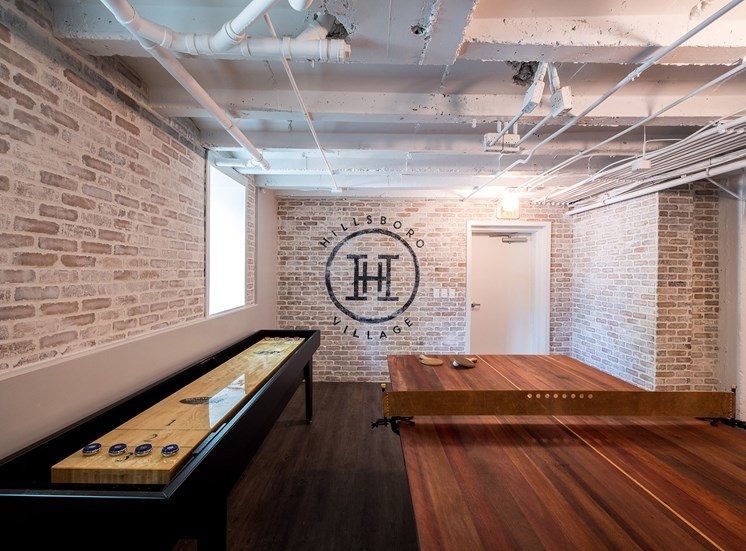 Game area with shuffleboard and table tennis