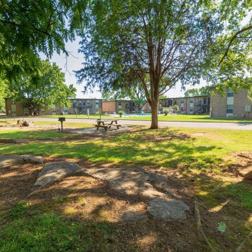 Condos at the Villager Landscaped Community Grounds with Picnic Tables and Ample Green Space