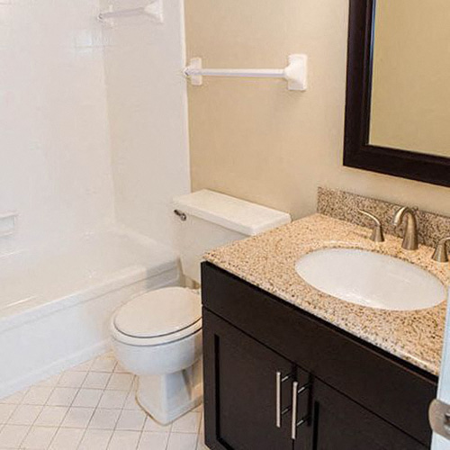 Condos at the Villager Bathroom with Shower Tub, Tile Flooring, and Modern Vanity