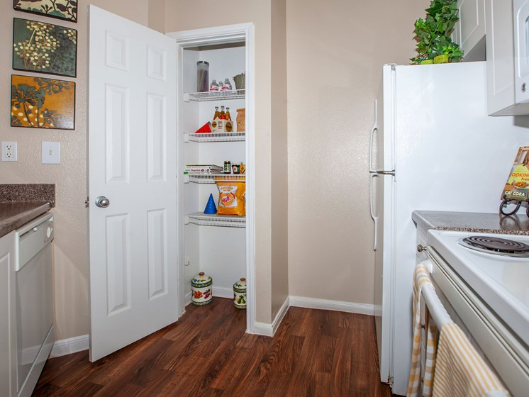 kitchen with pantry and refrigerator