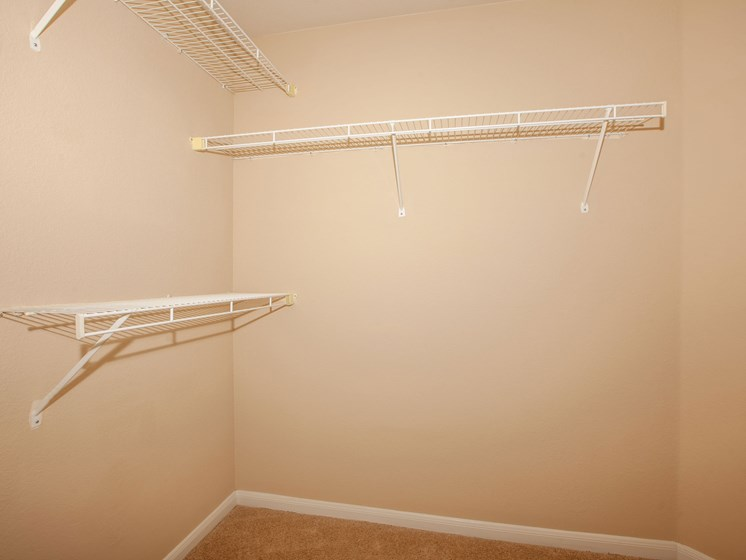 closet with three clothes racks