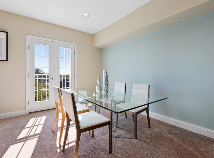 Furnished dining room with french doors at Market Street Flats apartments