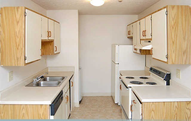 White Appliances In Kitchen at Ashley Village Apartments, Columbus, OH, 43232