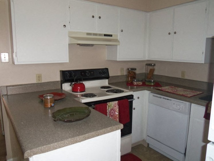 Kitchen Bar With Granite Counter Top And Modern Appliances at Colony West Apartments, Little Rock, AR, 72227