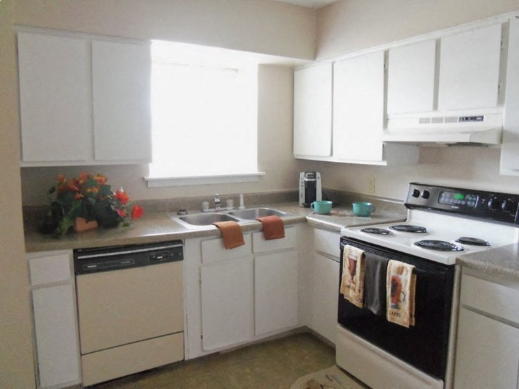 Kitchen With White Cabinetry And Appliances at Colony West Apartments, Little Rock, AR