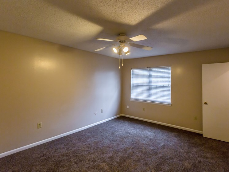 Carpeted Living Room With Ceiling Fan at Colony West Apartments, Arkansas, 72227