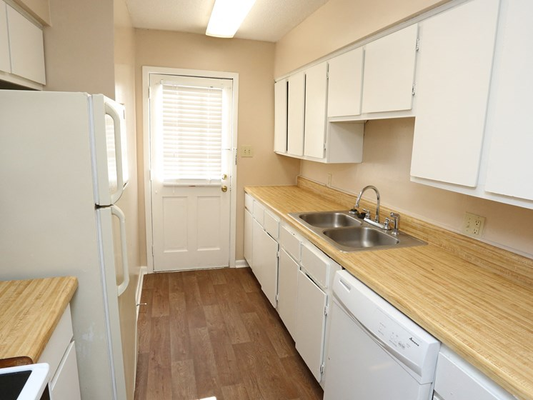 Kitchen With Custom Cabinetry at Colony West Apartments, Little Rock, AR, 72227