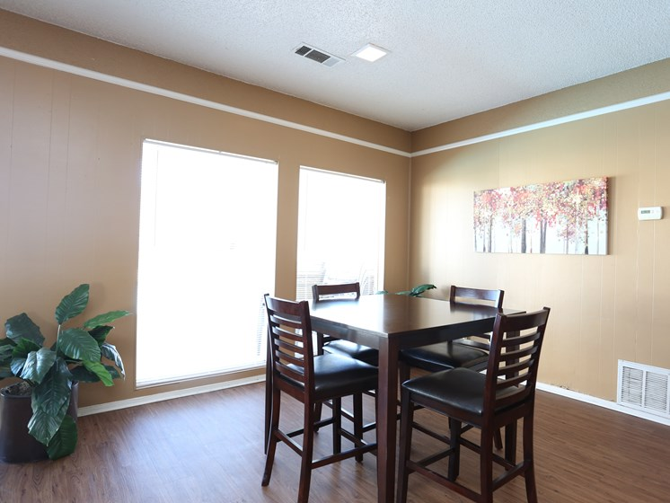 Comfy Leather Chairs With Dining Table at Towne Oaks Apartments, Little Rock, Arkansas