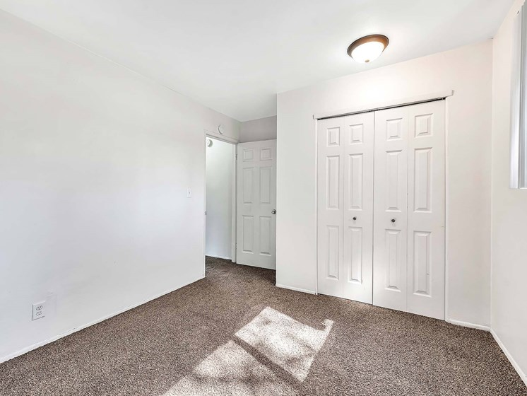 Bedroom With Closet at Rivershell Apartments, Lansing, MI