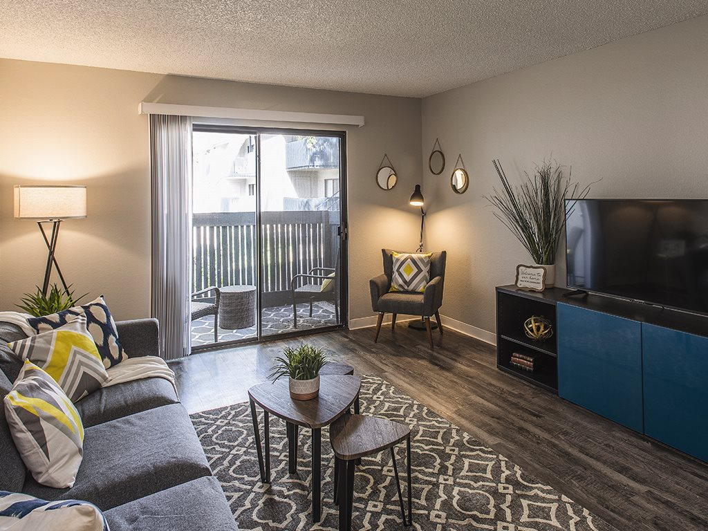 Living room with balcony at Cala Paradise Valley Apartments in Phoenix