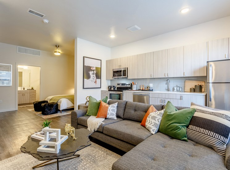 Comfortable Living Room with large Sofa at Railway Flats Apartments, Loveland, CO