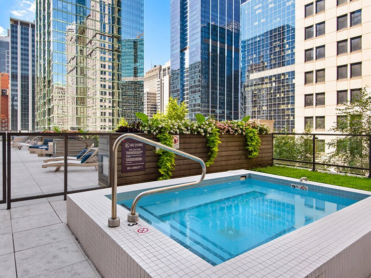 Outdoor hot tub with rooftop skyline views of Chicago
