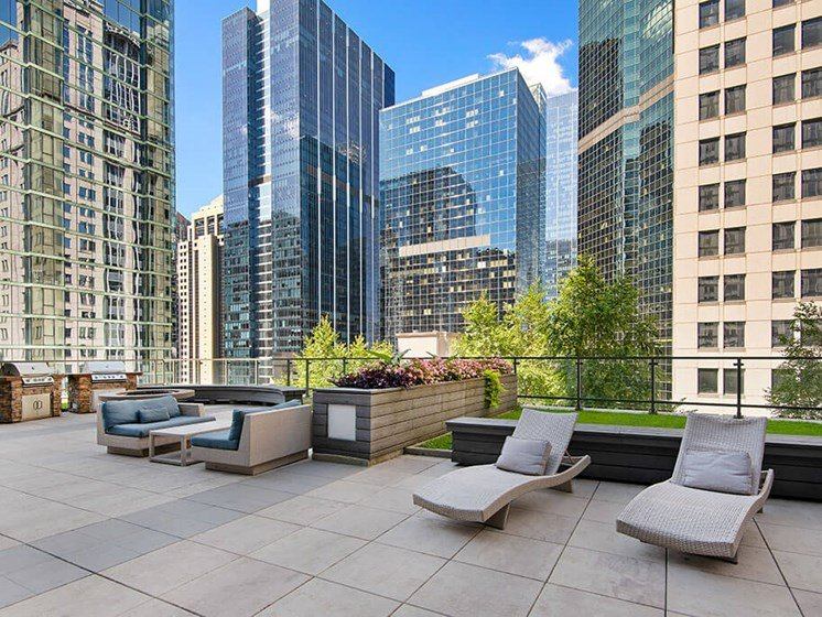 Rooftop resident lounge area with city views