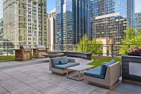 Rooftop resident lounge area with outdoor grilling stations