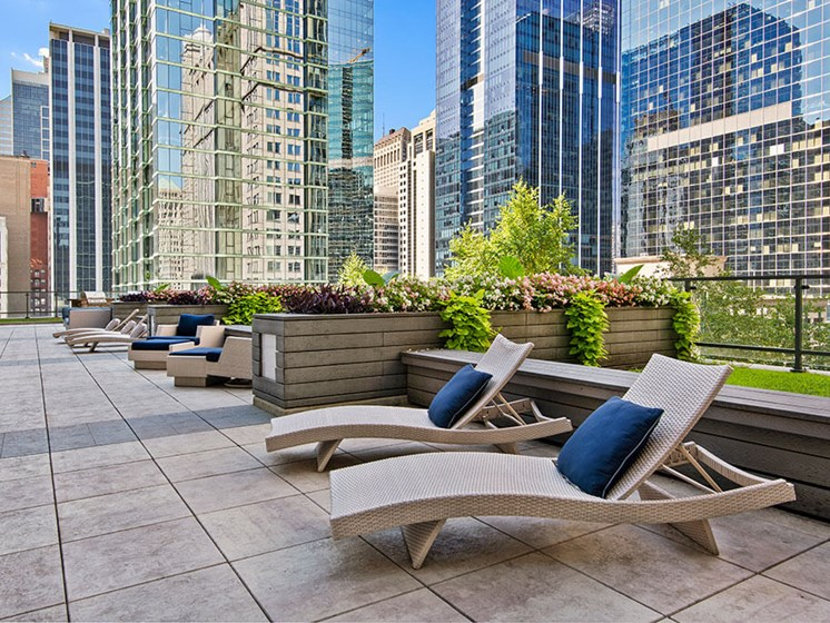 Rooftop outdoor lounge area with city views