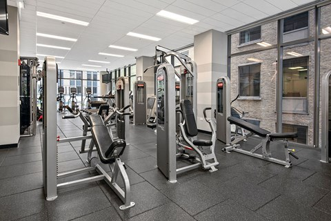 Fitness room with exercise equipment and floor-to-ceiling windows