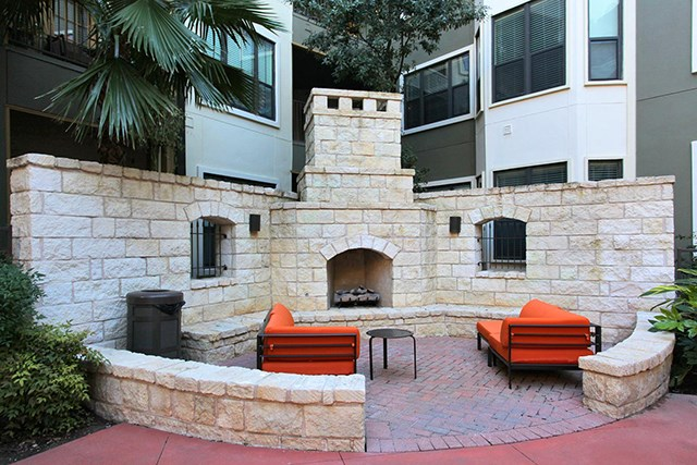 Outdoor Fireplace & Courtyard with couch seating