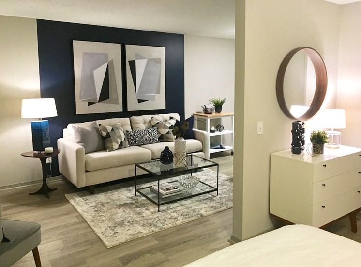Newly upgraded studio apartment bedroom looking into living room in Huntsville