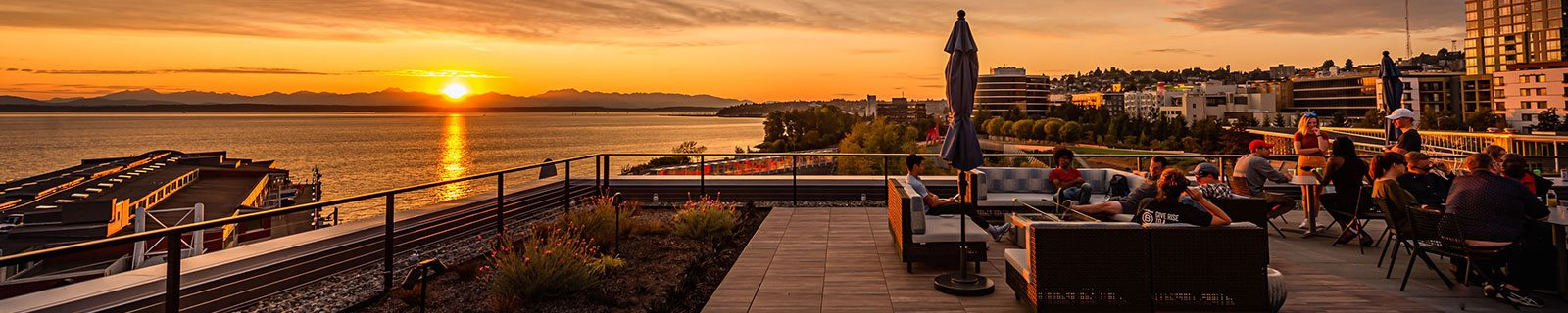 10 Clay Apartment's View of Sunset from Rooftop Terrace located in Seattle, Washington