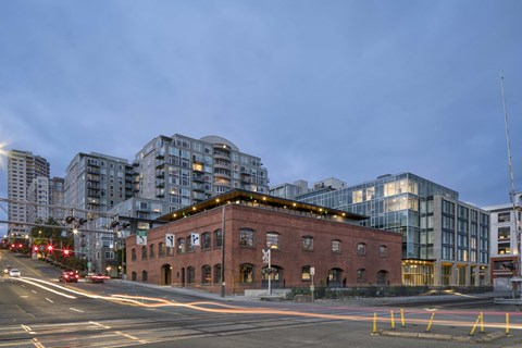 Property Exterior in Evening at 10 Clay Apartments in Seattle, WA