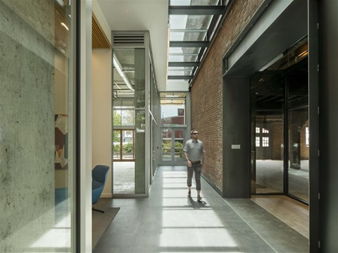 Hallway With Large Windows and Doors in Co-Working Space at 10 Clay Apartments in Seattle, WA, 98121