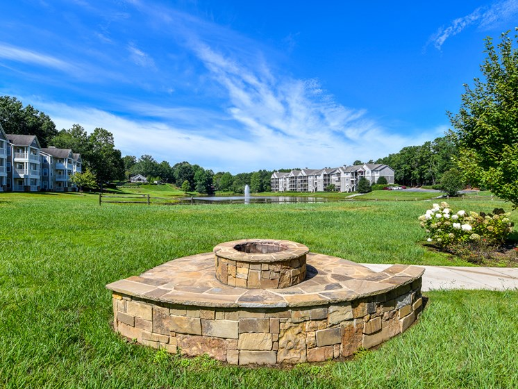 Fire pit and gathering space at Lakeside at Arbor Place apartment homes in Douglasville, GA  30135
