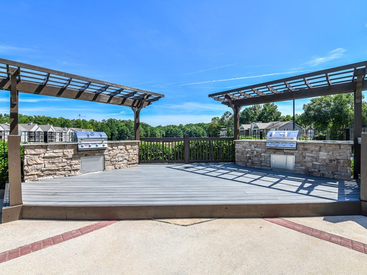 Renovated grilling area with entertaining deck at Lakeside at Arbor Place apartment homes in Douglasville, GA  30135