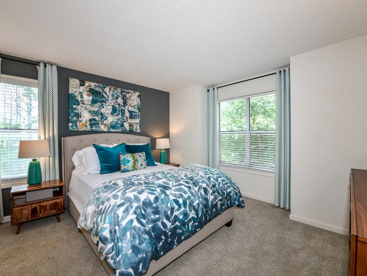 Renovated interiors featuring large picture windows and plush carpeting at Lakeside at Arbor Place in Douglasville, GA  30135