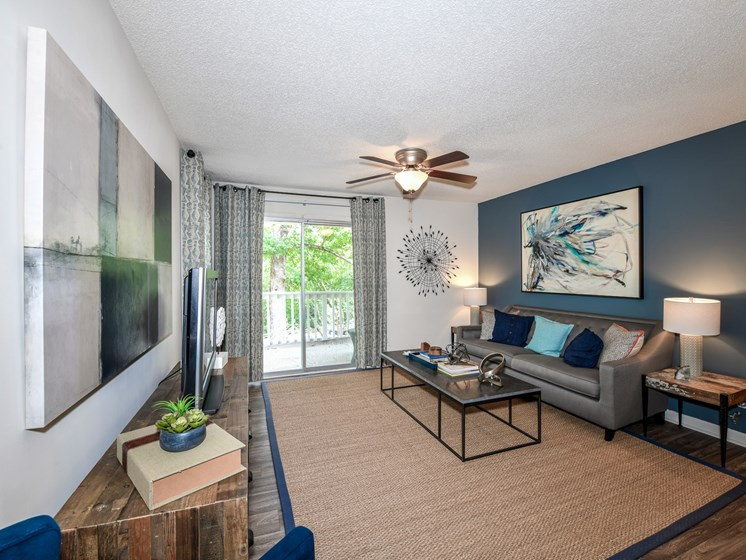 Renovated interiors featuring wood style flooring at Lakeside at Arbor Place apartment homes in Douglasville, GA 30135