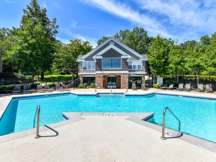 Refreshing swimming pool overlooking natural green spaces at Lakeside at Arbor Place apartment homes  n Douglasville, GA  30135