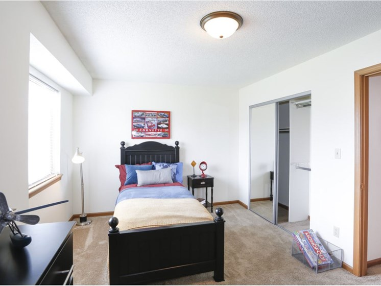 Guest bedroom with natural lighting at Villa West Apartments in Southwest Topeka, KS