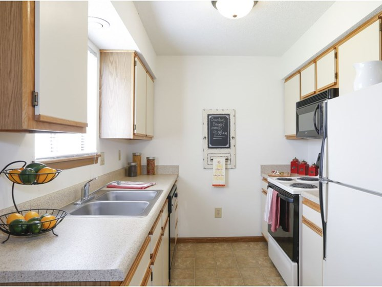 galley-style kitchen at Villa West Apartments in Southwest Topeka, KS