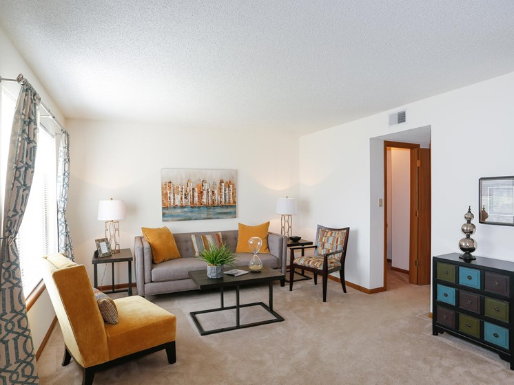 Large living room with natural light at Villa West Apartments in Southwest Topeka, KS
