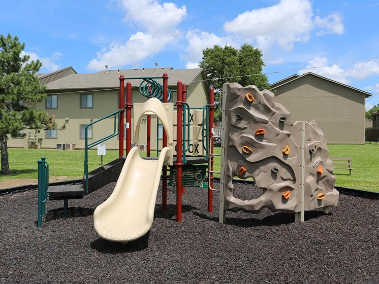 playground at Cozy living area at Villa West Apartments in Southwest Topeka, KS