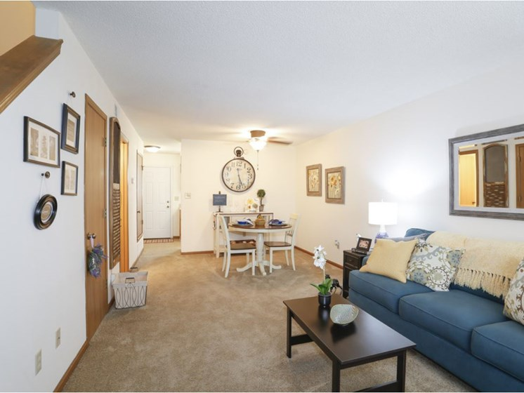 Cozy living room with natural light at Villa West Apartments in Southwest Topeka, KS