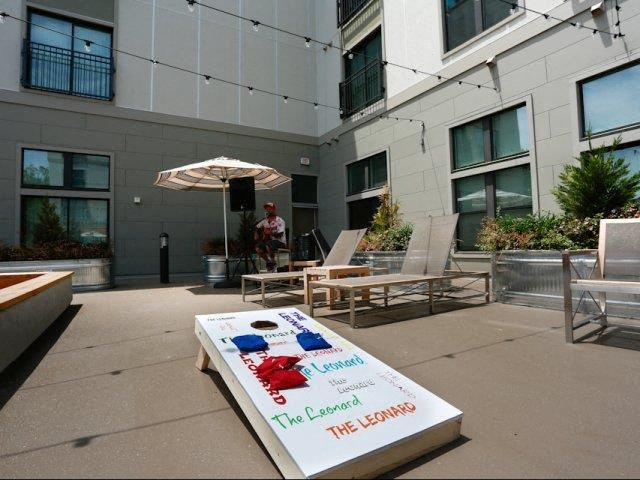 Amenities Deck with Lounging, Grilling, and Bocce Court at The George & The Leonard, Atlanta, GA