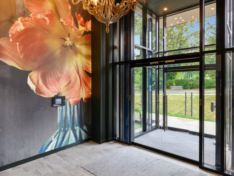 Hotel-like entrance to Wynnewood, PA apartment complex with elegant chandelier and art work