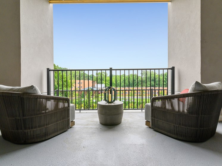 Arm chairs overlooking Wynnewood, PA on spacious balcony at The Palmer West