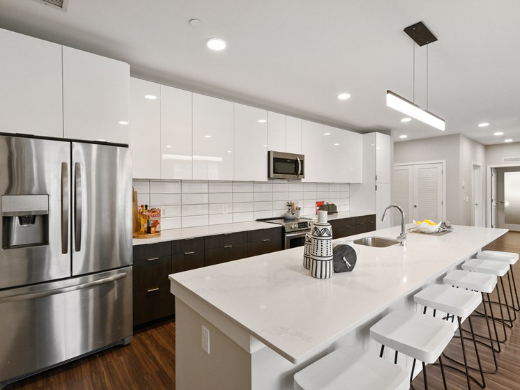 Gorgeous apartment kitchen in Wynnewood, PA with stainless steel appliances and white countertops